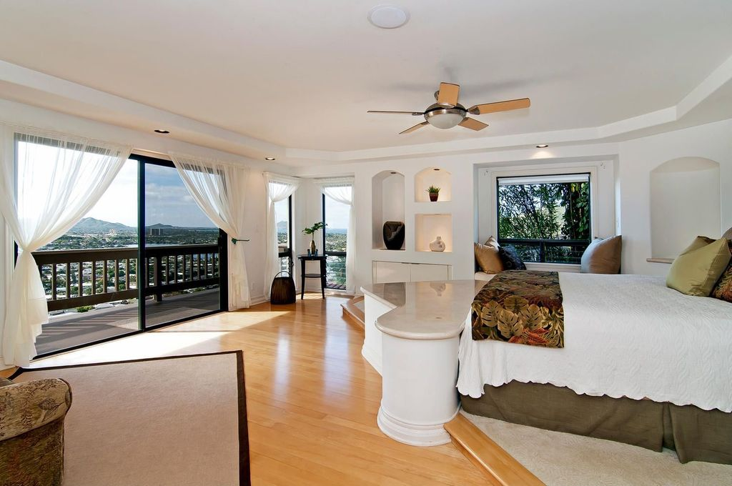 Contemporary Master Bedroom with Bamboo floors, Built-in bookshelf, flush light, sliding glass door, Ceiling fan, can lights