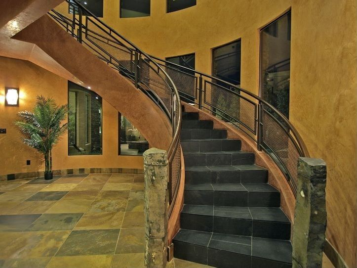Contemporary Staircase with can lights, soapstone tile floors, interior wallpaper, Metal staircase, curved staircase