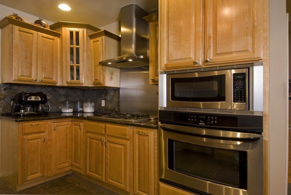 Traditional Kitchen with Simple granite counters, full backsplash, Framed Partial Panel, L-shaped, Large Ceramic Tile