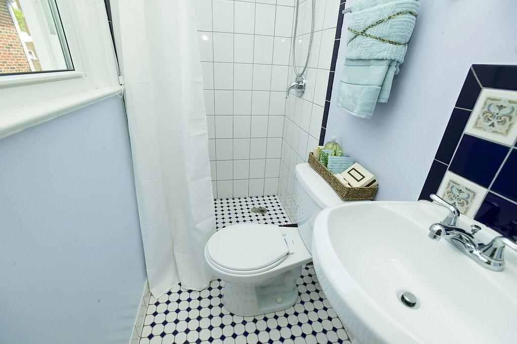 Contemporary 3/4 Bathroom with tile backsplash, Handheld showerhead, Towel warmer, Casement, Pedestal sink, Shower, Paint
