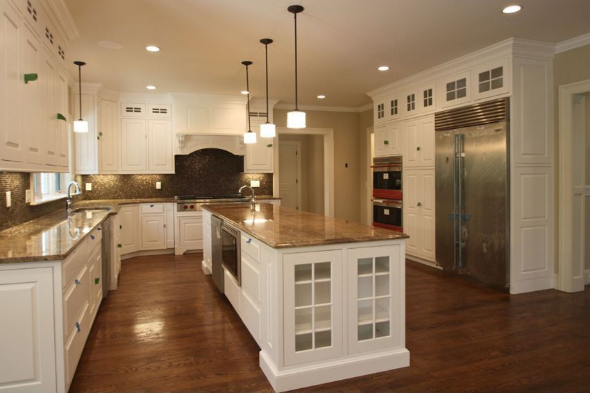 Traditional Kitchen with wall oven, Kitchen island, Standard height, Pendant light, Undermount sink, Hardwood floors