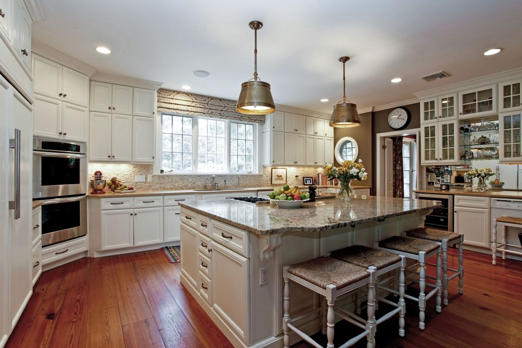 Traditional Kitchen with can lights, Stone Tile, Built In Panel Ready Refrigerator, U-shaped, full backsplash, Glass panel