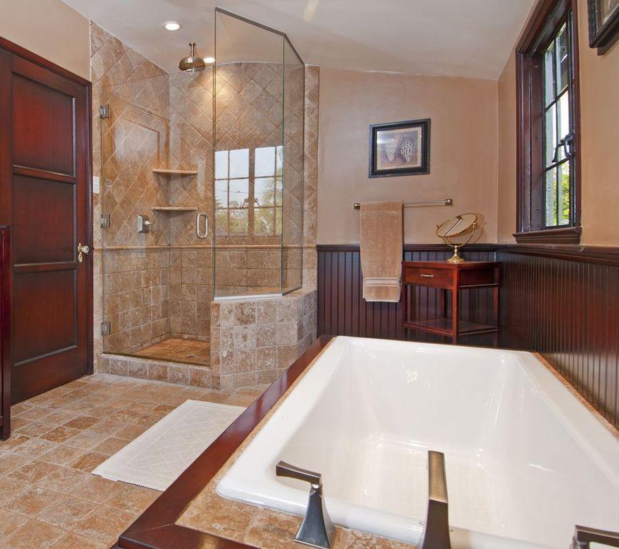 Craftsman Master Bathroom with stone tile floors, Paint, frameless showerdoor, Wainscotting, Casement, can lights, Bathtub
