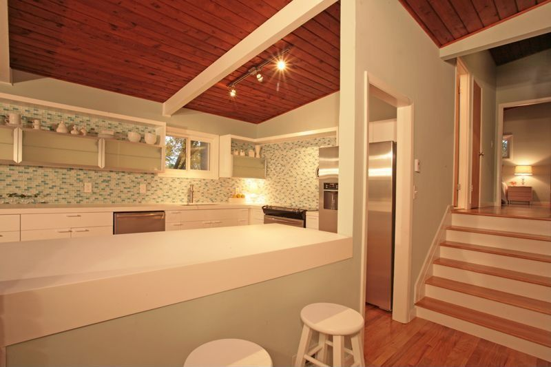 Contemporary Kitchen with Exposed beam, flush light, dishwasher, Standard height, Glass panel, Paint, Hardwood floors, Flush