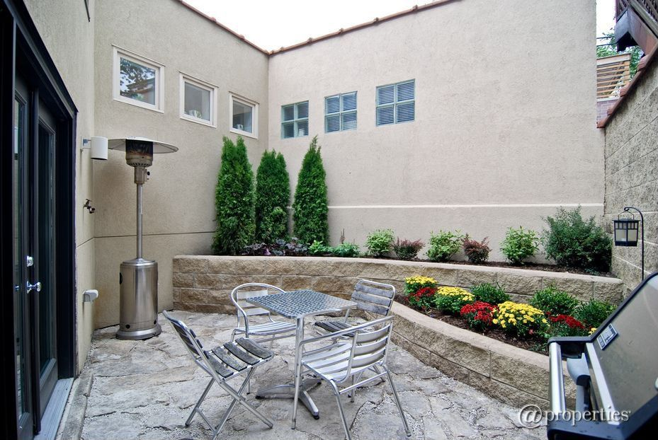 Traditional Patio with French doors, exterior stone floors, Raised beds, Fence, picture window, Outdoor kitchen