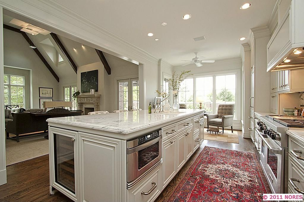 Traditional Kitchen with Custom hood, Framed Partial Panel, gas range, Complex granite counters, Hardwood floors, can lights