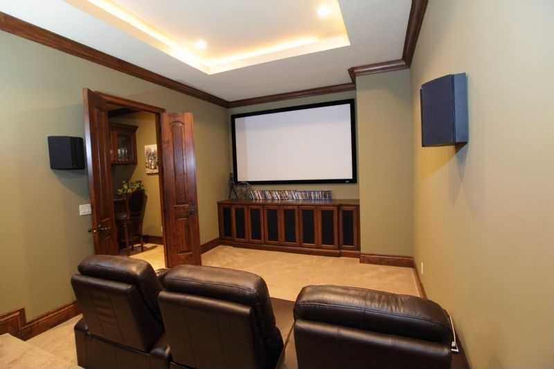 Craftsman Home Theater with Built-in bookshelf, Carpet, French doors, Crown molding, can lights, Standard height