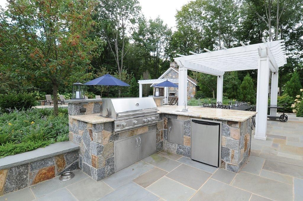 Contemporary Patio with Trellis, Raised beds, Outdoor kitchen, exterior stone floors