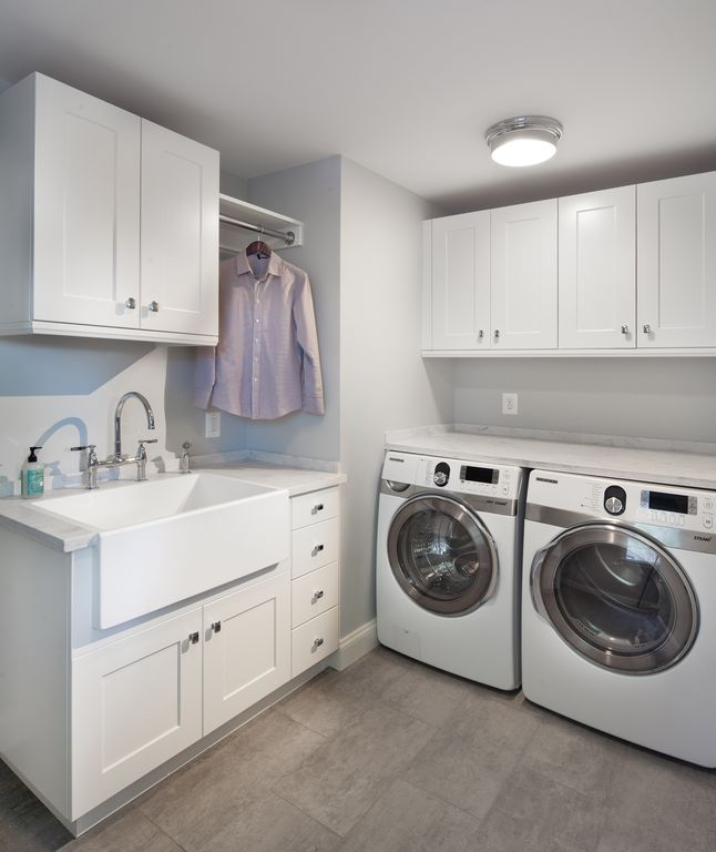Traditional Laundry Room with Farmhouse sink, Concrete tile , Built-in ...