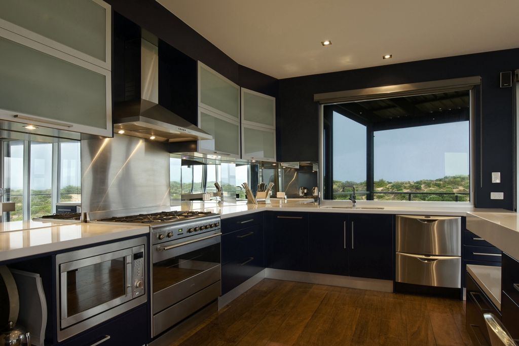 Contemporary Kitchen with Stainless Steel, built-in microwave, Undermount sink, U-shaped, double dishwasher, full backsplash