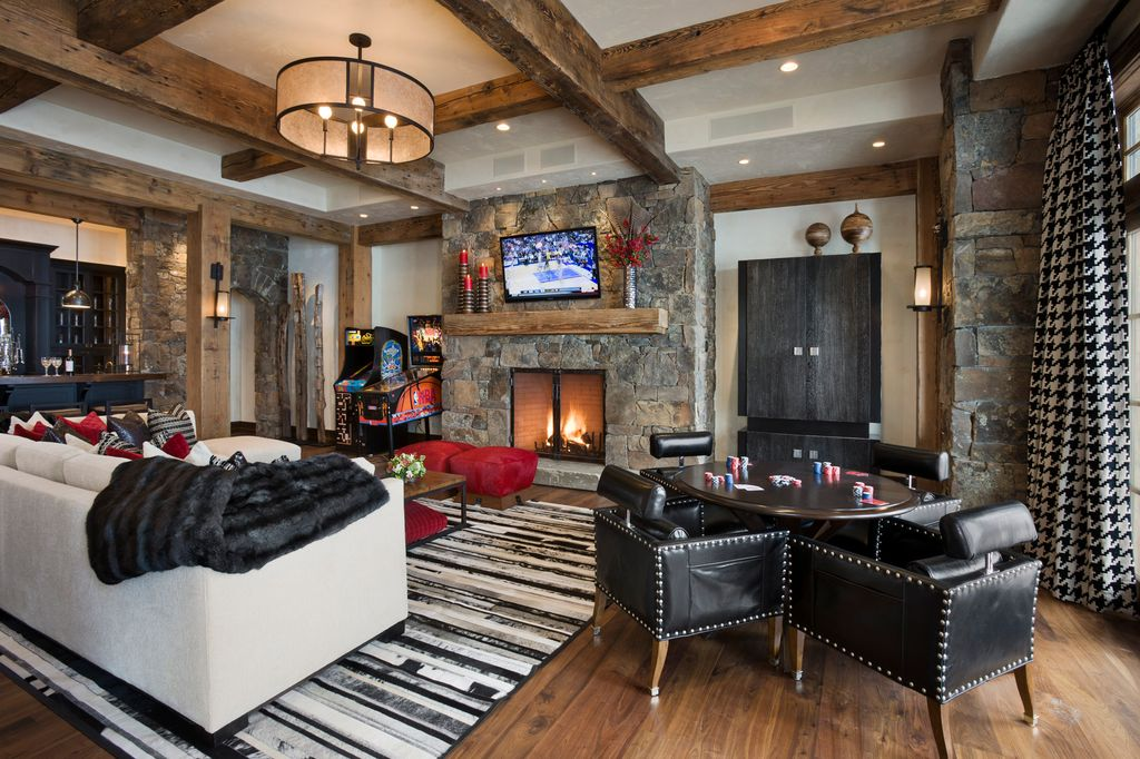"Contemporary Game Room with stone fireplace, Restoration hardware riveted mesh round chandelier 40"", Standard height, Columns"