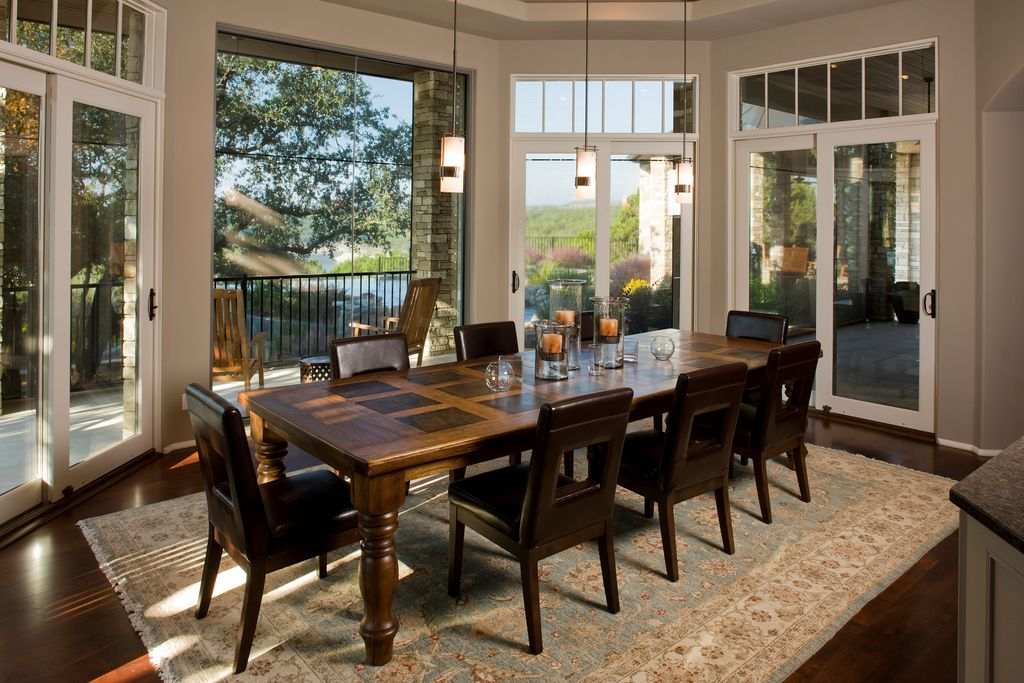 Contemporary Dining Room with sliding glass door, High ceiling, Hardwood floors, Transom window, Pendant light, can lights