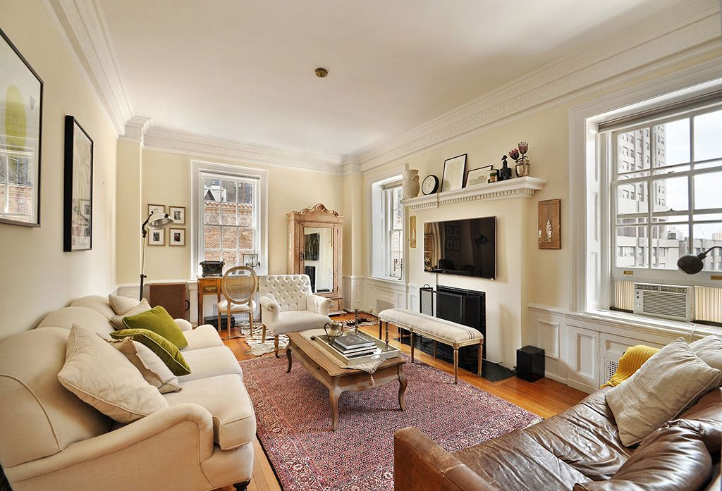 Traditional Living Room with insert fireplace, Fireplace, Wainscotting, Crown molding, double-hung window, Hardwood floors