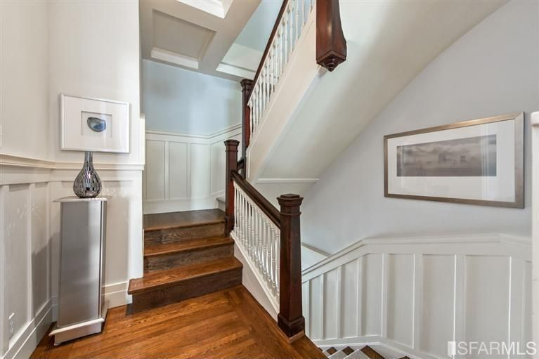 Traditional Hallway with Hardwood floors, Wainscotting, Box ceiling, Standard height