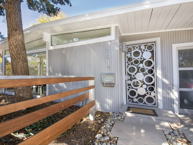 Modern Front Door with exterior tile floors, exterior concrete tile floors, specialty window, Fence, French doors
