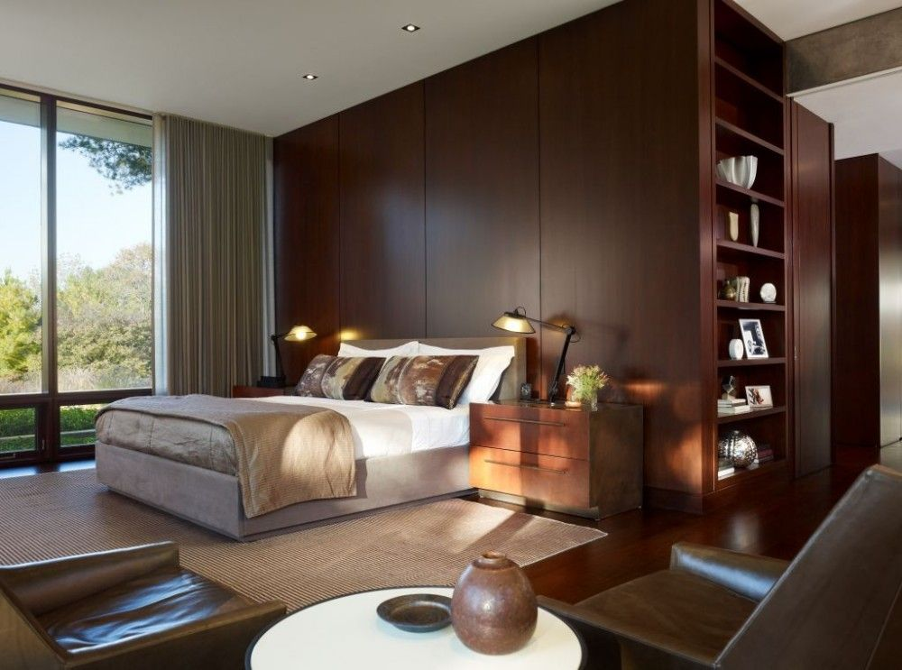 Contemporary Master Bedroom with can lights, Paint 1, Standard height, Hardwood floors, picture window, Built-in bookshelf