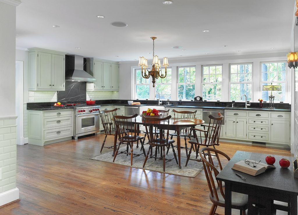 Traditional Kitchen with Wall Hood, Soapstone counters, Farmhouse sink, Flat panel cabinets, Wall sconce, gas range, L-shaped