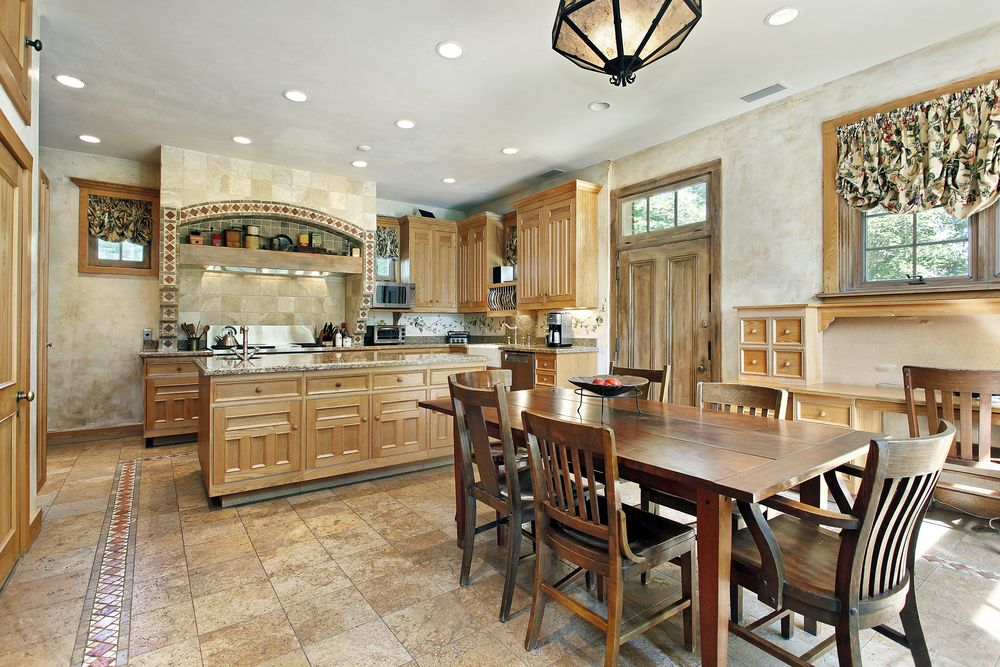 Rustic Kitchen with Complex granite counters, flush light, limestone tile floors, Breakfast nook, specialty door, can lights