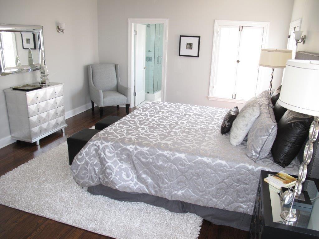 Art Deco Master Bedroom with Hardwood floors, Wall sconce, Casement, Standard height, flat door