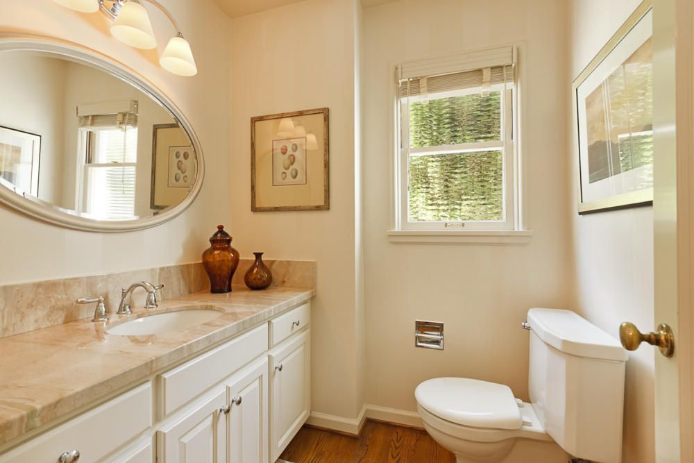 Traditional Powder Room with Hardwood floors, Inset cabinets, Raised panel, Powder room, partial backsplash, Standard height