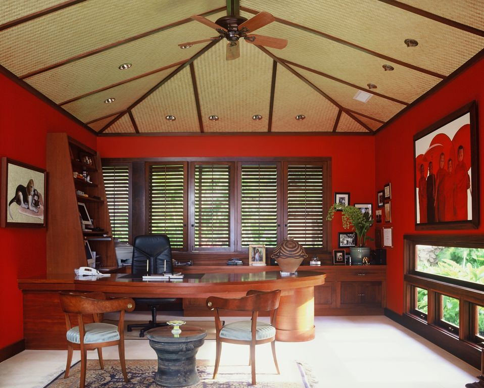 Tropical Home Office with can lights, Exposed beam, Standard height, Ceiling fan, Built-in bookshelf, Carpet, Casement