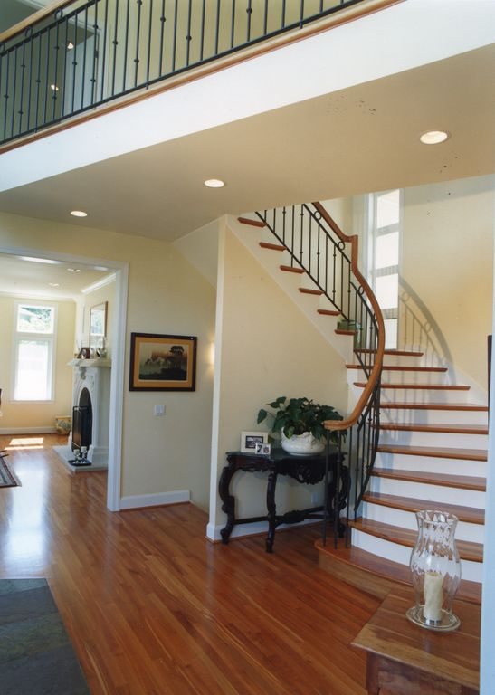 Traditional Staircase with Hardwood floors, High ceiling