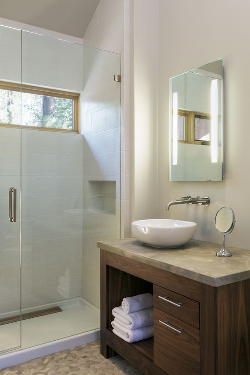 Contemporary Master Bathroom with Vessel sink, Limestone counters, wall-mounted above mirror bathroom light, Casement, Flush