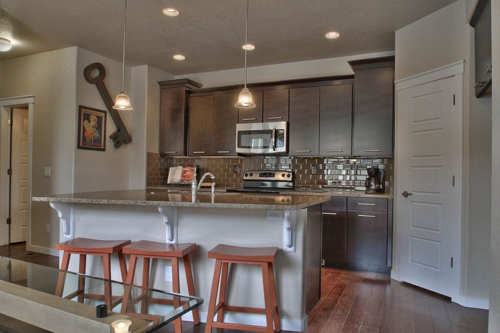 Contemporary Kitchen with Paint 1, specialty door, full backsplash, Over the range microwave, Standard height, Subway Tile