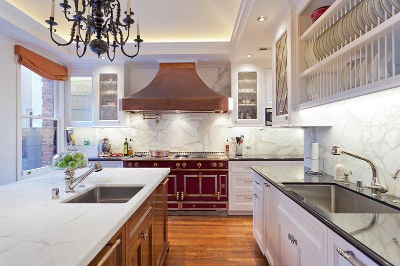 Traditional Kitchen with High ceiling, Casement, Flat panel cabinets, built-in microwave, Complex marble counters, Chandelier