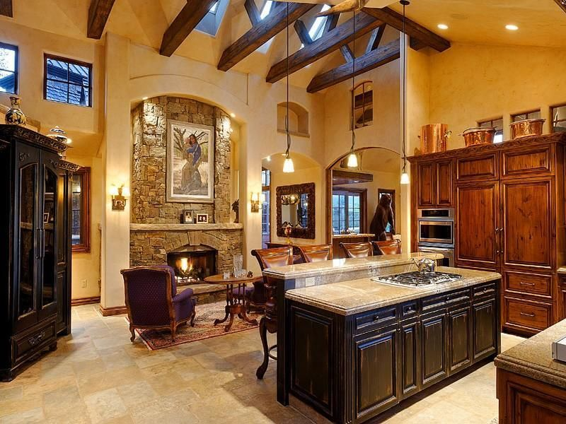 Country Kitchen with Cathedral ceiling, U-shaped, Kitchen island, double wall oven, Exposed beam, can lights, Breakfast bar