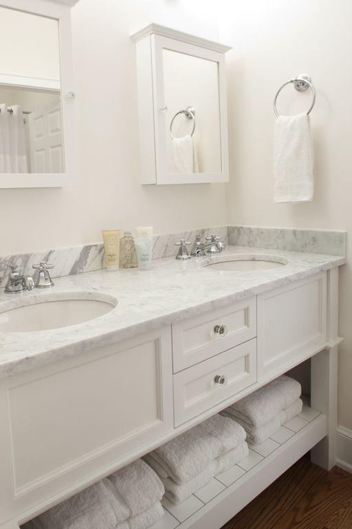 Cottage Master Bathroom with Undermount sink, Flat panel cabinets, Double sink, Hardwood floors, six panel door, Shower