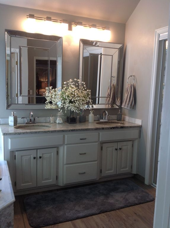 Traditional Master Bathroom with Limestone Tile, Complex granite counters, Undermount sink, Standard height, Raised panel