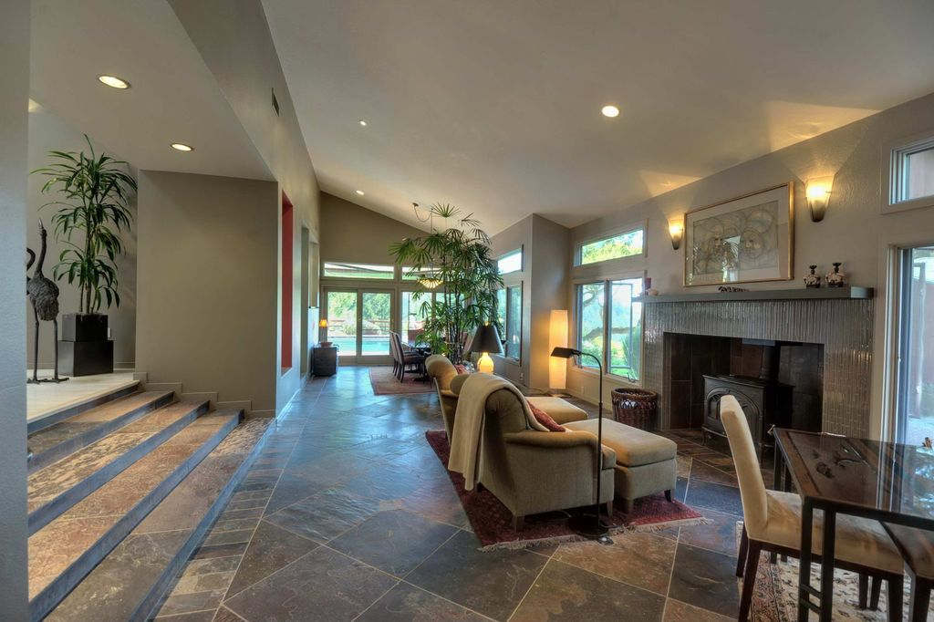 Contemporary Living Room with Wood Stove fireplace, picture window, stone tile floors, Standard height, Wall sconce, Casement
