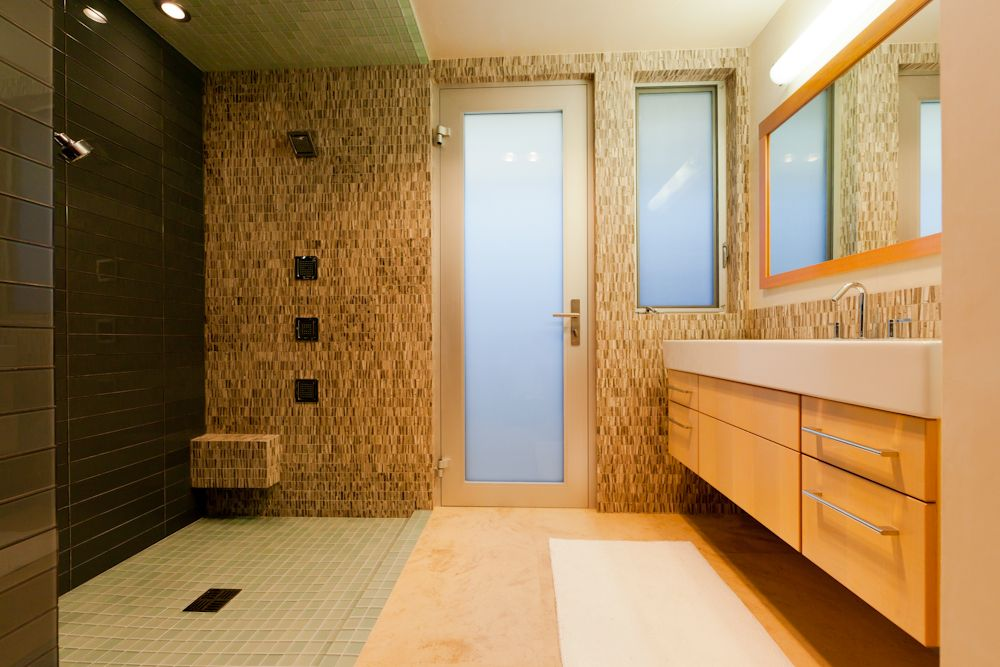 Contemporary 3/4 Bathroom with Glass panel door, Flush, Undermount sink, Corian counters, European Cabinets, Ceramic Tile