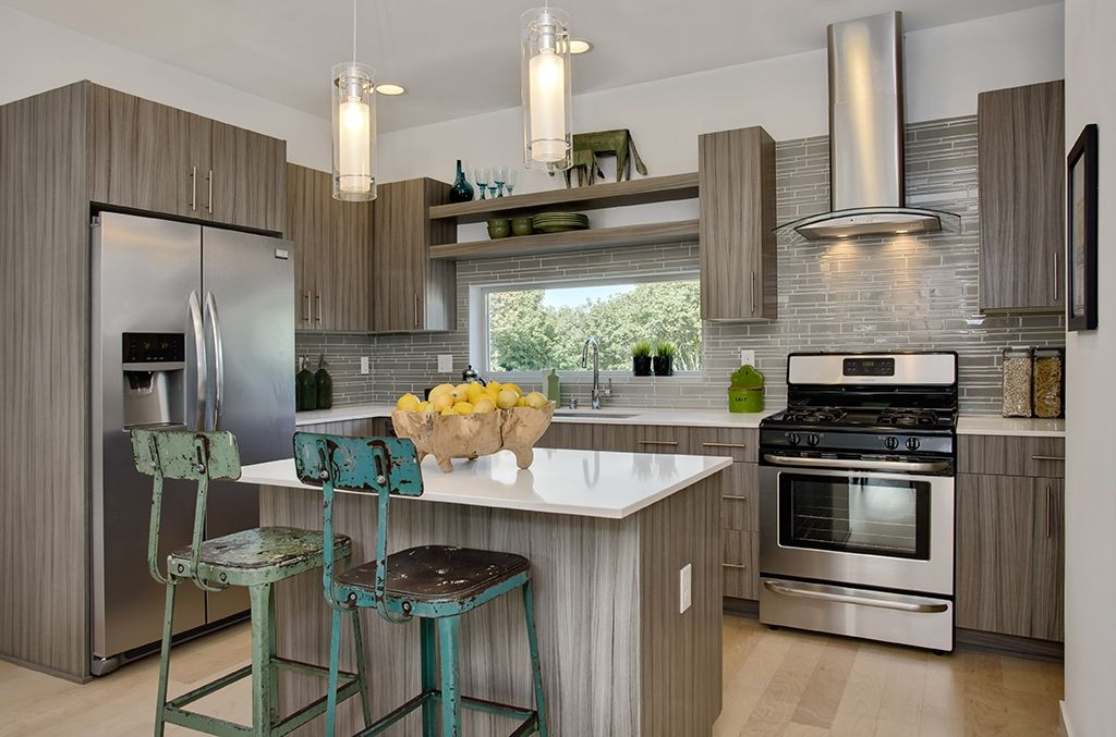 Contemporary Kitchen with can lights, Undermount sink, L-shaped, Kitchen island, Breakfast bar, Wall Hood, European Cabinets