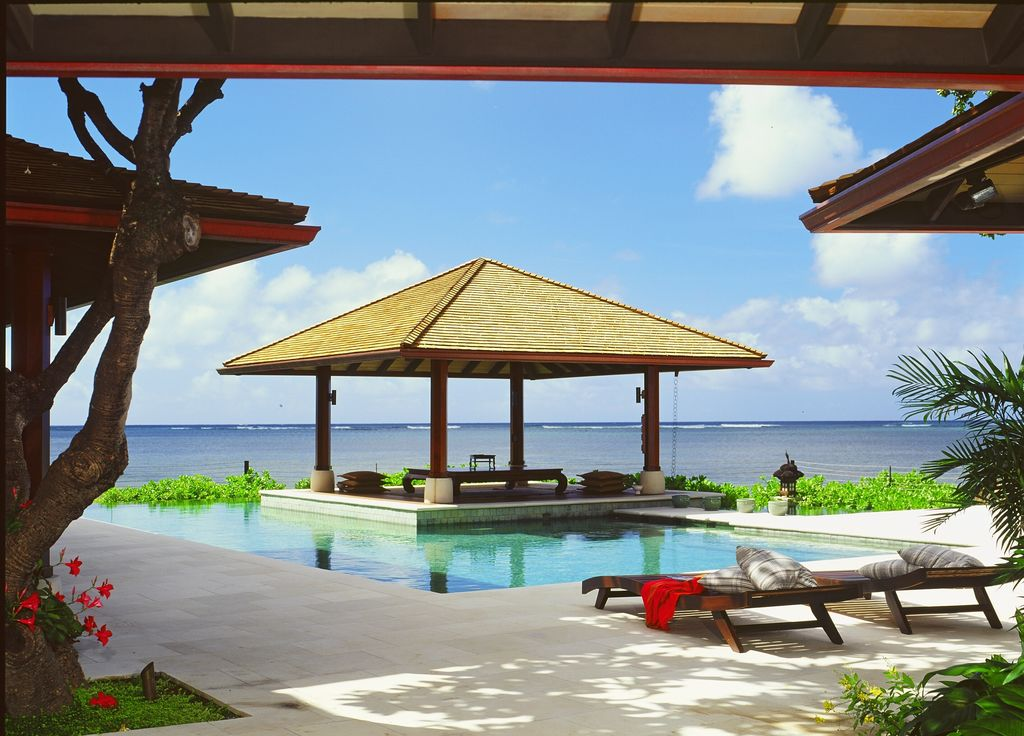 Tropical Swimming Pool with Infinity pool, Stone Tile, Outdoor lounge area, Meditation hut