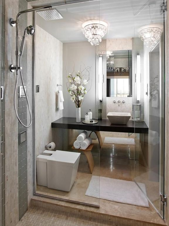 Contemporary 3/4 Bathroom with frameless showerdoor, Handheld showerhead, Scabos travertine tumbled mosaic, Wall sconce