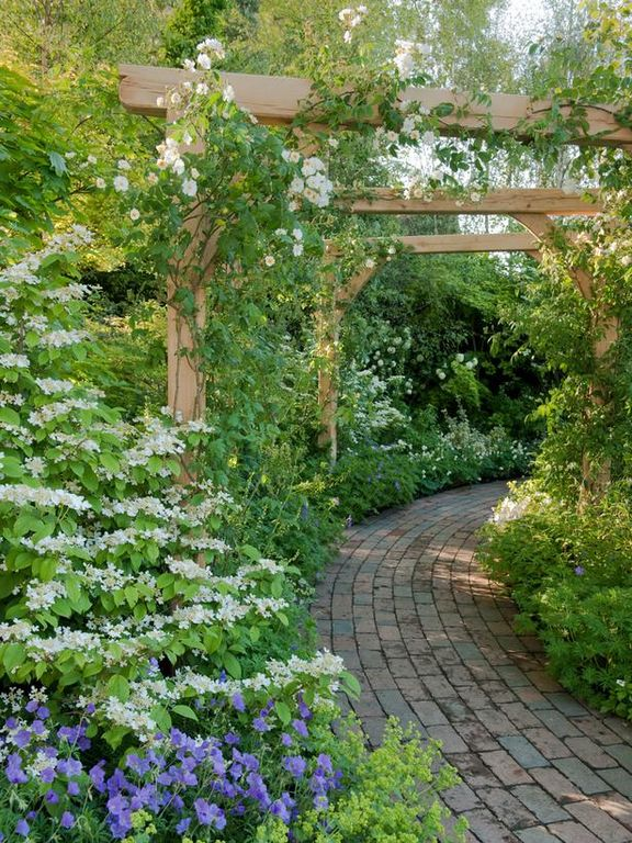 Cottage Landscape/Yard with exterior brick floors, Trellis, Pathway