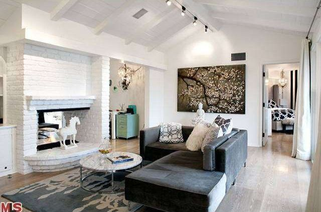 Eclectic Living Room with Fireplace, Exposed beam, Standard height, flush light, brick fireplace, Hardwood floors