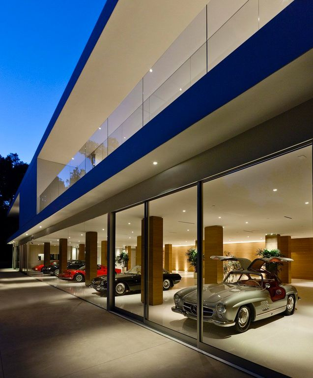 Contemporary Garage with Standard height, Full height  glass, Columns, can lights, picture window, Concrete floors, Concrete