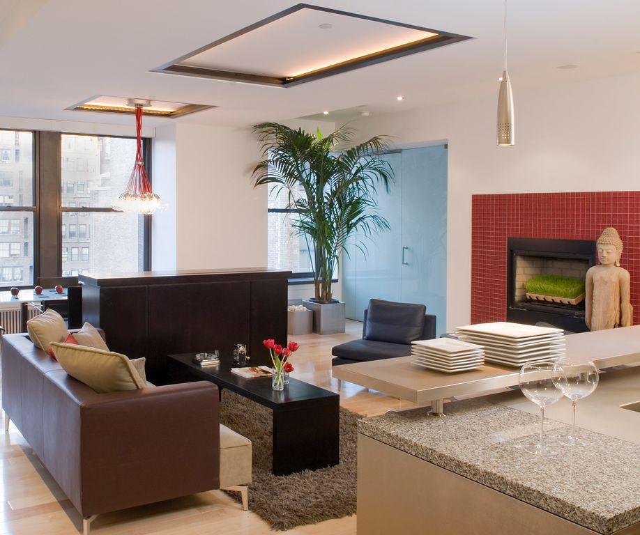 Contemporary Living Room with brick fireplace, Pendant light, Chandelier, flat door, Standard height, double-hung window