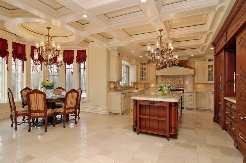 Traditional Kitchen with full backsplash, limestone tile floors, dishwasher, Chandelier, can lights, Complex marble counters