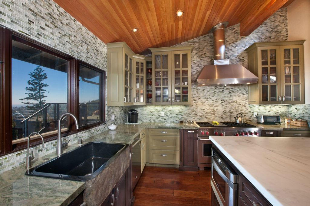 Country Kitchen with Ceramic Tile, full backsplash, picture window, Kitchen island, Inset cabinets, Complex marble counters