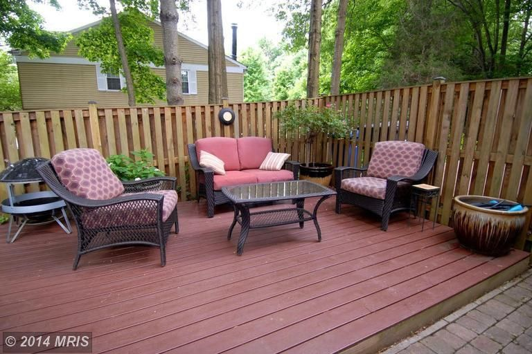 Traditional Patio with Fire pit, Outdoor wicker furniture, Wood deck, Wood privacy fence, Fence