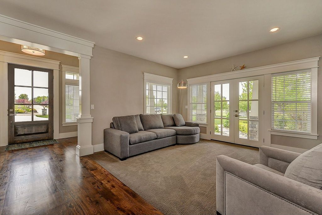 Traditional Living Room with Columns, Standard height, French doors, Hardwood floors, double-hung window, can lights
