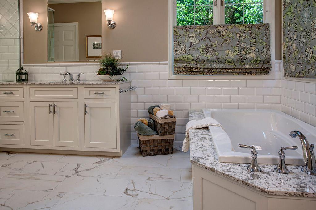 Traditional Master Bathroom with Shower, stone tile floors, six panel door, Casement, Large Ceramic Tile, Bathtub, Paint 1