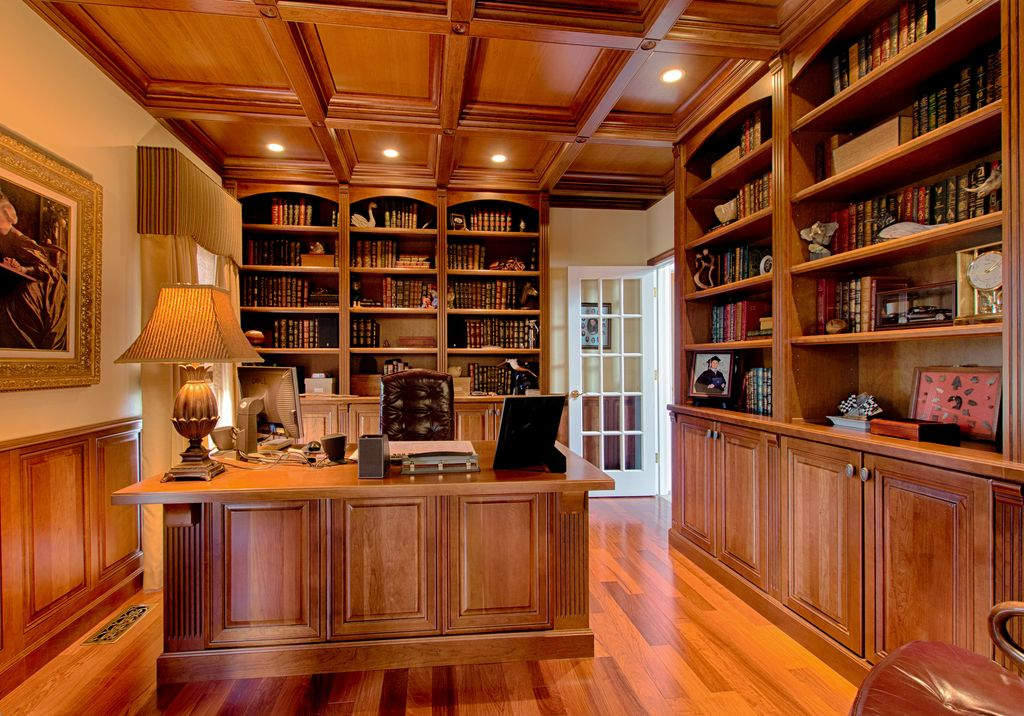 Traditional Home Office with Hardwood floors, Built-in bookshelf, French doors, Crown molding, Standard height, can lights