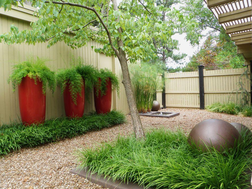 Modern Landscape/Yard with Raised beds, Pathway, Fence, Lloyd Vase Planter