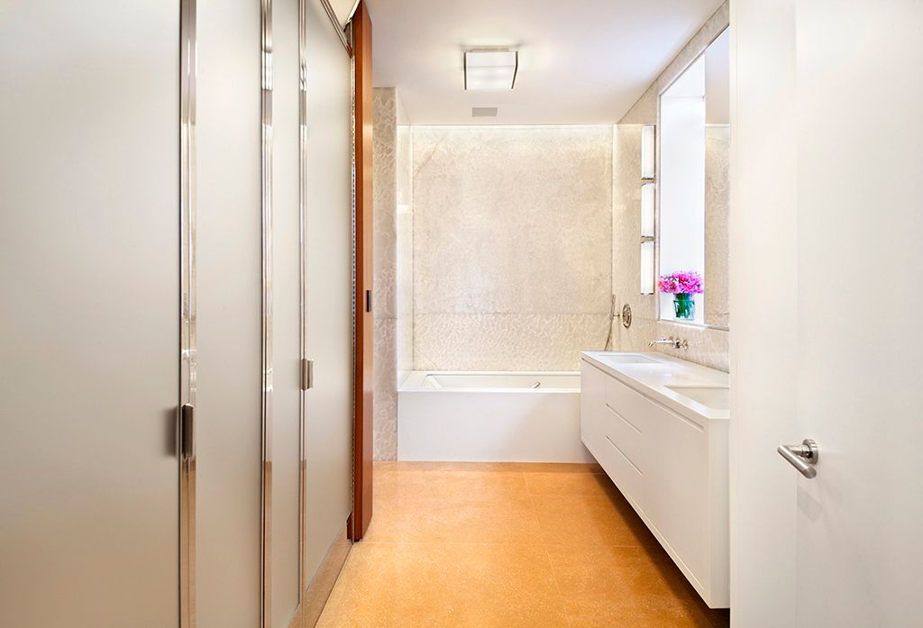Contemporary Master Bathroom with Undermount sink, Dupont corian designer white, Wall sconce, flat door, Double sink, Bathtub