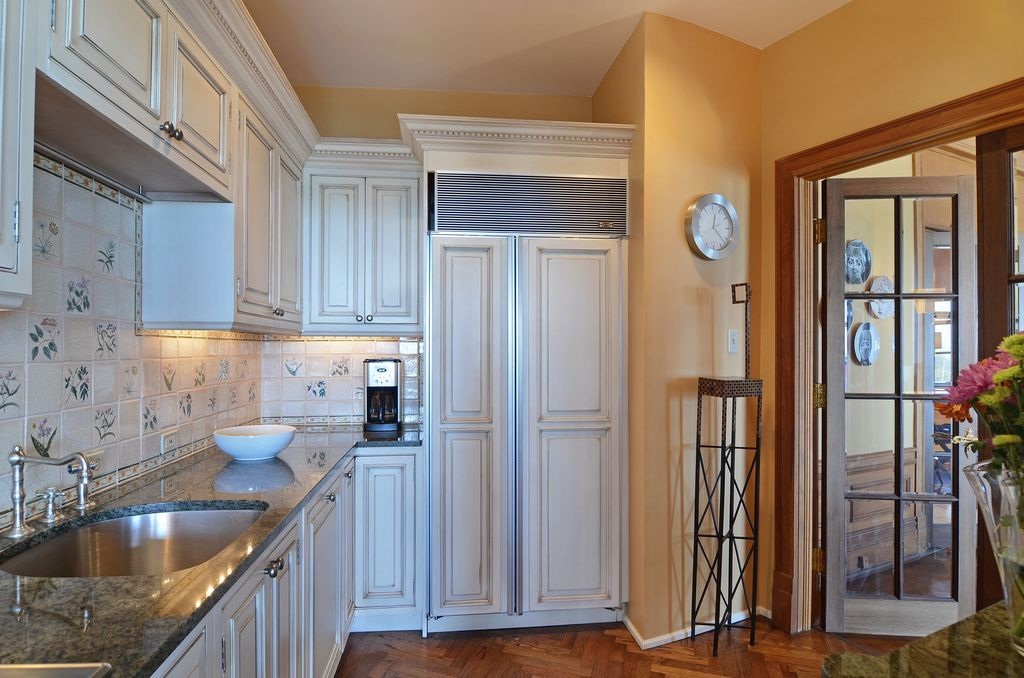 Traditional Kitchen with Flush, Hardwood floors, Stone Tile, Raised panel, Undermount sink, Complex granite counters